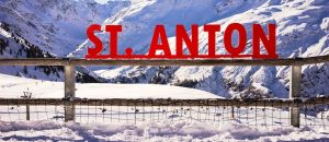 st anton panorama 300x130 - A red sign with St. Anton with the Vorarlberg as a snowy background